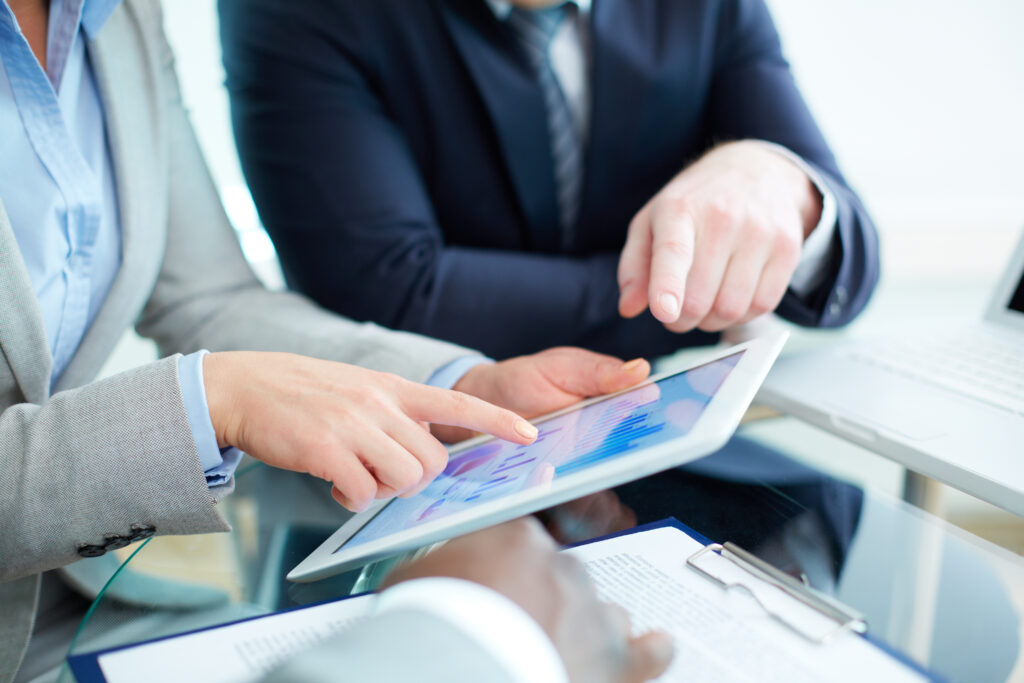 close-up-businesswoman-pointing-digital-tablet